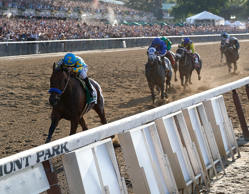 . American Pharoah (5) with Victor Espinoza up leads the pack as he approaches the finish line during the 147th running of the Belmont Stakes horse race at Belmont Park, Saturday, June 6, 2015, in Elmont, N.Y. American Pharoah won to be the first horse to win the Triple Crown since Affirmed did it in 1978. (AP Photo/Julio Cortez)