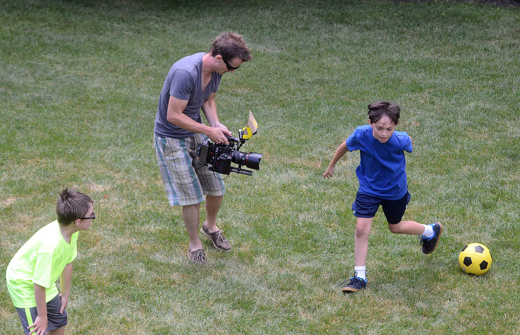 ". Evan Kole, who is the young lead in the movie ""Papou,\"" is filmed during a soccer scene being filmed on location at a home in Novi, Thursday July 25, 2013. (Oakland Press Photo:Vaughn Gurganian)"