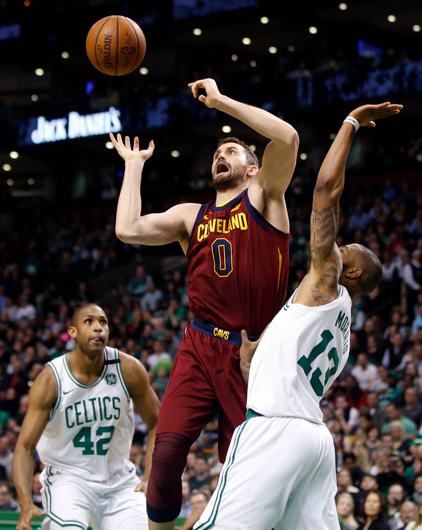 . Cleveland Cavaliers center Kevin Love (0) loses control of the ball against the defense of Boston Celtics forwards Al Horford (42) and Marcus Morris (13) during the first quarter of Game 1 of the NBA basketball Eastern Conference Finals, Sunday, May 13, 2018, in Boston. (AP Photo/Michael Dwyer)
