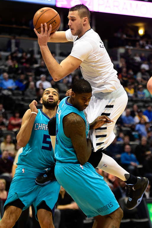 . Marvin Williams (2) of the Charlotte Hornets fouls Danilo Gallinari (8) of the Denver Nuggets as Nicolas Batum (5) stands by during the first quarter. The Denver Nuggets hosted the Charlotte Hornets at the Pepsi Center on Sunday, January 10, 2016. (Photo by AAron Ontiveroz/The Denver Post)