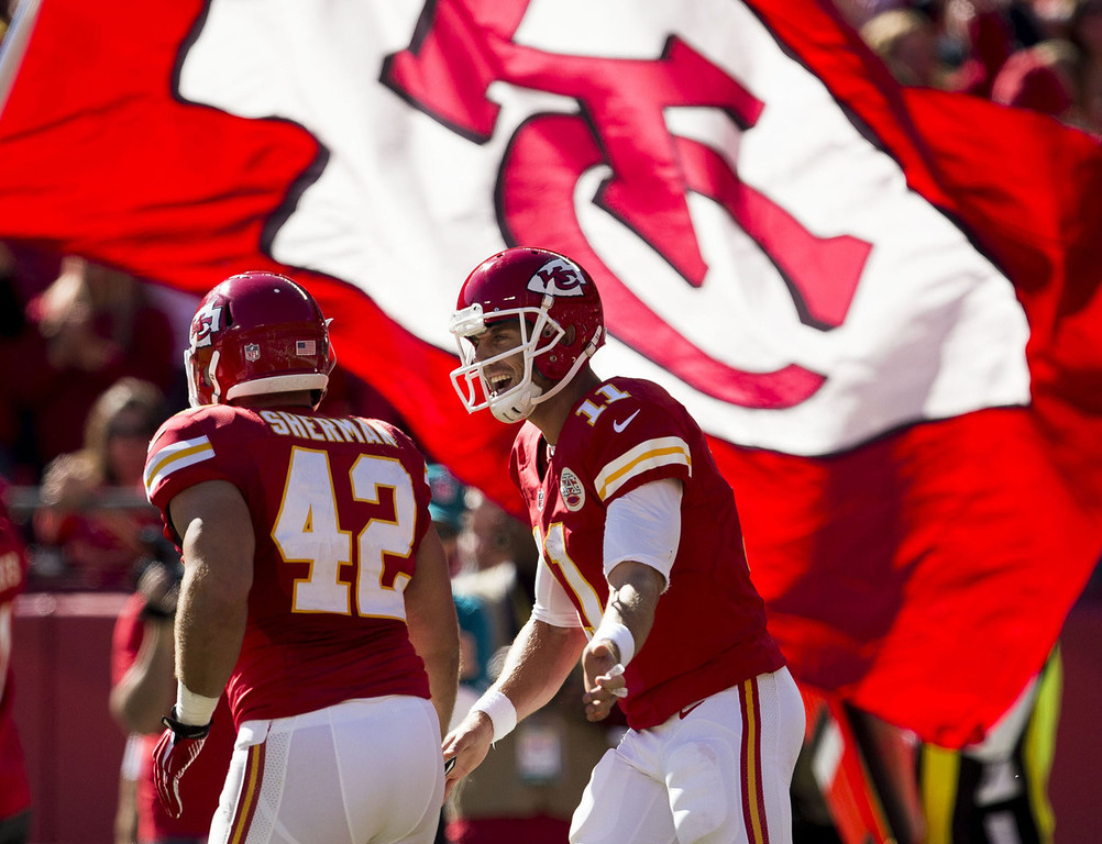 . Fullback Anthony Sherman #42 of the Kansas City Chiefs celebrates with quarterback Alex Smith #11 after scoring a touchdown during the game against the Cleveland Browns at Arrowhead Stadium on October 27, 2013 in Kansas City, Missouri. (Photo by David Welker/Getty Images)