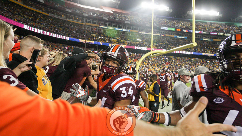 RB Travon McMillian high fives fans in the front row as the Hokies celebrate the win. (Mark Umansky/TheKeyPlay.com)