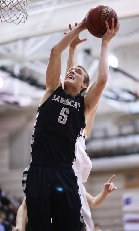 . Brandon Bodnar of Fossil Ridge High School (5) is in action in the 2nd half of the game against Monarch High School at Monarch High School Gym. (Photo by Hyoung Chang/The Denver Post)