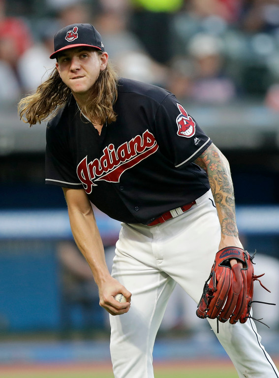 . Cleveland Indians starting pitcher Mike Clevinger reacts after Cincinnati Reds\' Joey Votto hit a solo home run in the fifth inning of a baseball game, Monday, July 9, 2018, in Cleveland. (AP Photo/Tony Dejak)