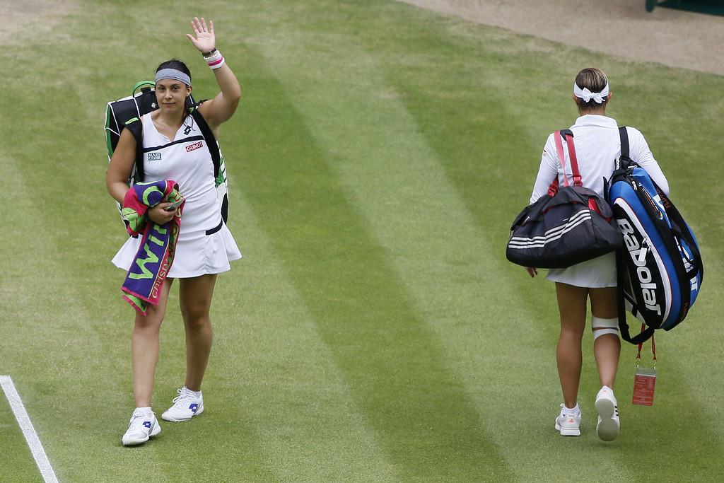 . France\'s Marion Bartoli (L) waves as she leaves the court following her victory over Belgium\'s Kirsten Flipkens in their women\'s singles semi-final match on day ten of the 2013 Wimbledon Championships tennis tournament at the All England Club in Wimbledon, southwest London, on July 4, 2013. Bartoli won 6-1, 6-2.  KIRSTY WIGGLESWORTH/AFP/Getty Images
