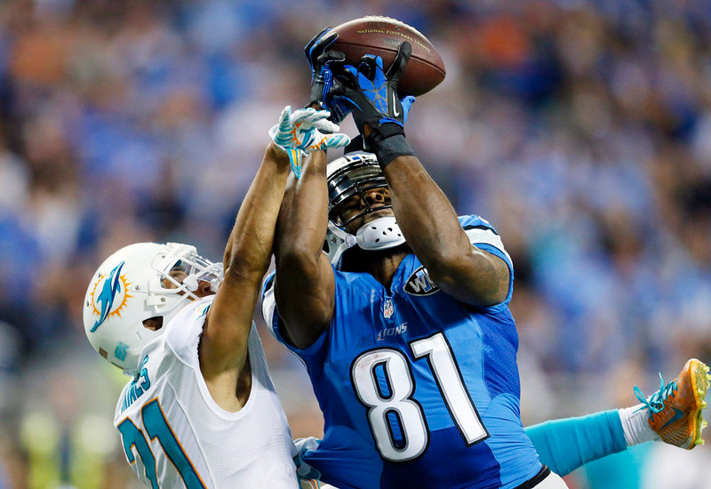 . Detroit Lions wide receiver Calvin Johnson (81), defended by Miami Dolphins cornerback Brent Grimes (21), catches 49-yard pass for a touchdown during the first half of an NFL football game in Detroit, Sunday, Nov. 9, 2014. (AP Photo/Rick Osentoski)