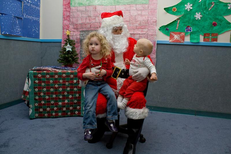 Bev and Quinn sit on Santa's lap
