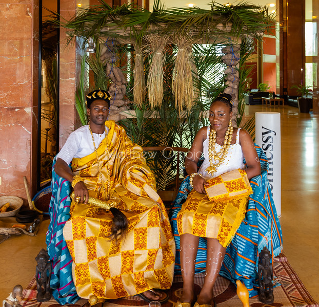 African ivorian culture on display at the president hotel Yamoussoukro. Young man and lady wearing traditional african dress with gold jewelry. Promoting culture. Body decoration on the lady, African hairstyle, cap,