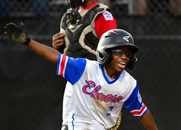 8/10/2019 Mike Orazzi | Staff New Jersey Elmora Youth Little League's Josiah Sharpe (7) after scoring during Saturday's Mid Atlantic Final baseball game with New York at Breen Field in Bristol, Conn.