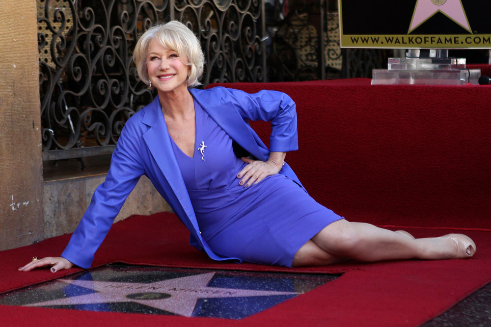 """Description of . Helen Mirren poses with her newly-unveiled star, the 2,488th star on the Hollywood Walk of Fame, in Hollywood, California, January 3, 2013. The multi major award-winning actress was recently nominated for a Golden Globe Award by the Hollywood Foreign Press Association for Best Actress in a Motion Picture: Drama and for a Screen Actors Guild Award for Best Actress in a Motion Picture Drama. Mirren will appear in the HBO biopic \""""Phil Spector\"""" later this year.   REUTERS/David McNew ("""
