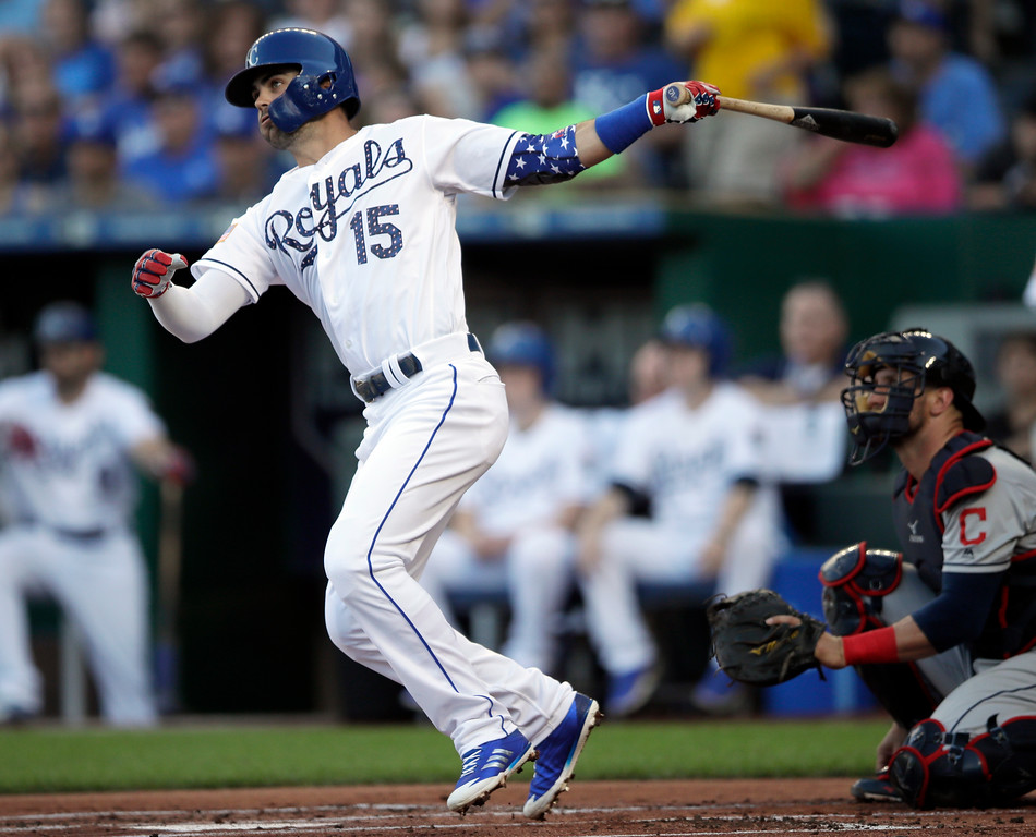 . Kansas City Royals\' Whit Merrifield hits a solo home run off Cleveland Indians starting pitcher Corey Kluber during the first inning of a baseball game at Kauffman Stadium in Kansas City, Mo., Monday, July 2, 2018. (AP Photo/Orlin Wagner)