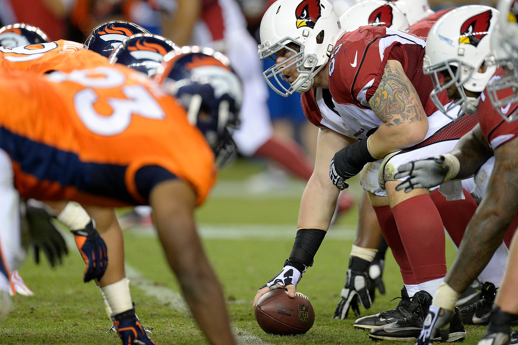 . Arizona Cardinals tackle Mike Gibson (69) lines up the denver defense during the third quarter on August 29, 2013 at Sports Authority Field at Mile High. The Denver Broncos hosted the Arizona Cardinals in the final game of the preseason. (Photo by John Leyba/The Denver Post)