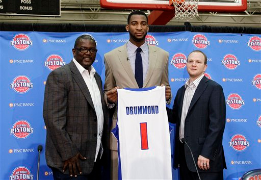 . Detroit Pistons \' general manager Joe Dumars, left, and head coach Lawrence Frank, right, stand with their first-round draft choice, Andre Drummond, in Auburn Hills, Mich., Friday, June 29, 2012. (AP Photo/Paul Sancya)