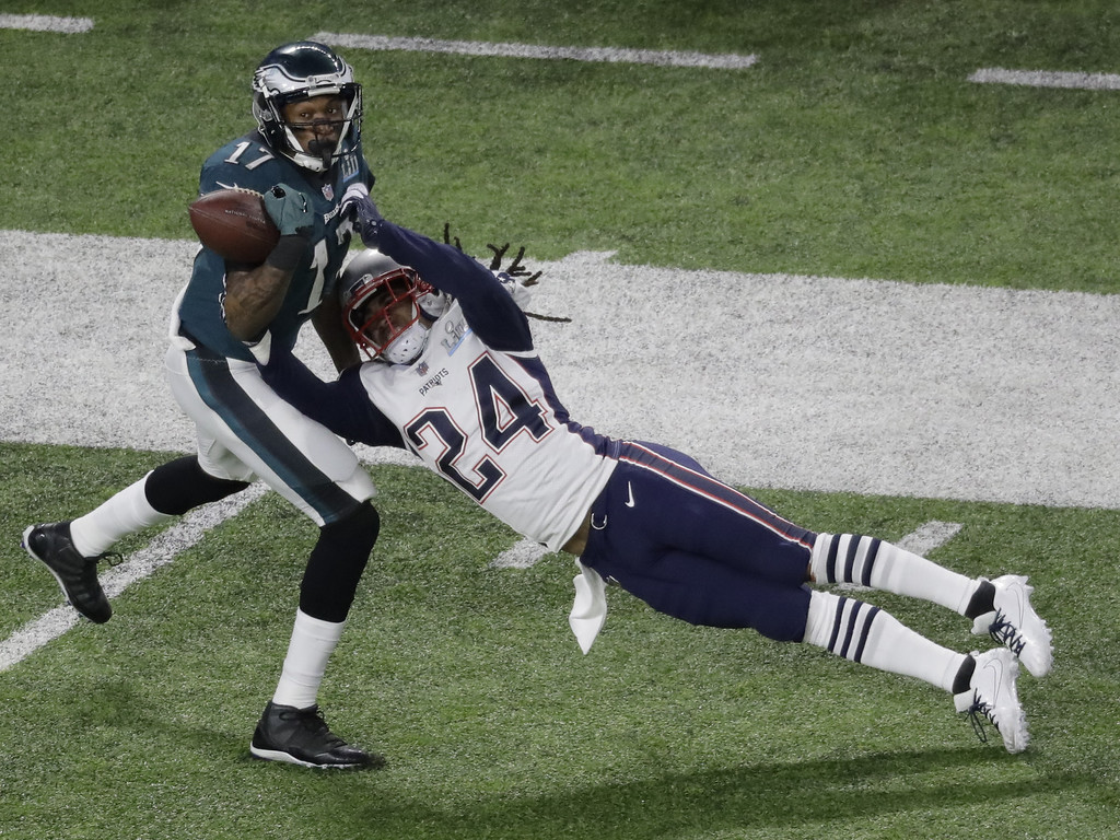 . New England Patriots cornerback Stephon Gilmore breaks up a pass intended for Philadelphia Eagles wide receiver Alshon Jeffery during the first half of the NFL Super Bowl 52 football game Sunday, Feb. 4, 2018, in Minneapolis. The pass was later incepted by New England Patriots strong safety Duron Harmon. (AP Photo/Eric Gay)