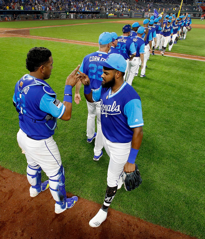 . Kansas City Royals\' Salvador Perez, left, and Jorge Bonifacio celebrate after the team\'s baseball game against the Cleveland Indians on Saturday, Aug. 25, 2018, in Kansas City, Mo. The Royals won 7-1. (AP Photo/Charlie Riedel)