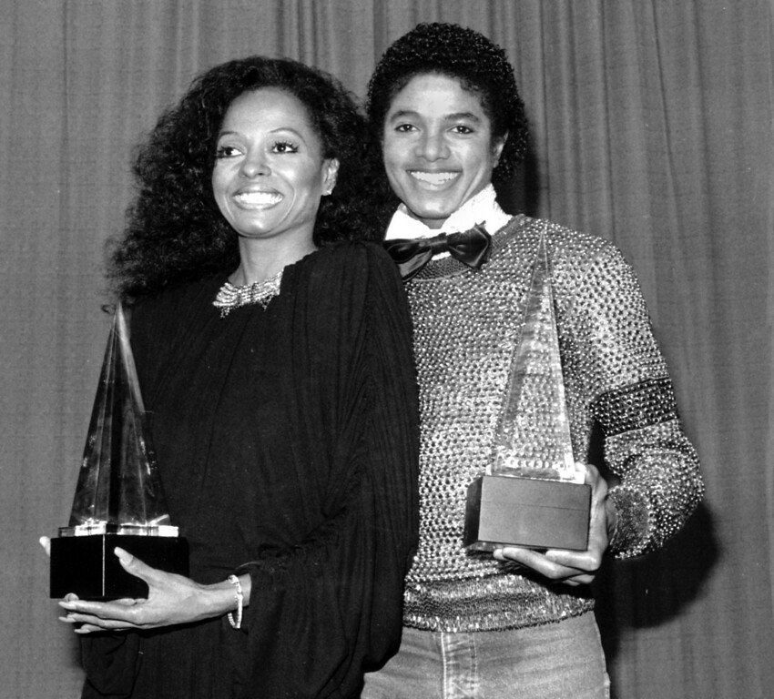 . Singers Michael Jackson, right, and Diana Ross hold their American Music Awards in Los Angeles on Jan. 30, 1981.  Jackson won for favorite soul album and Ross won for favorite female soul vocalist.  (AP Photo)