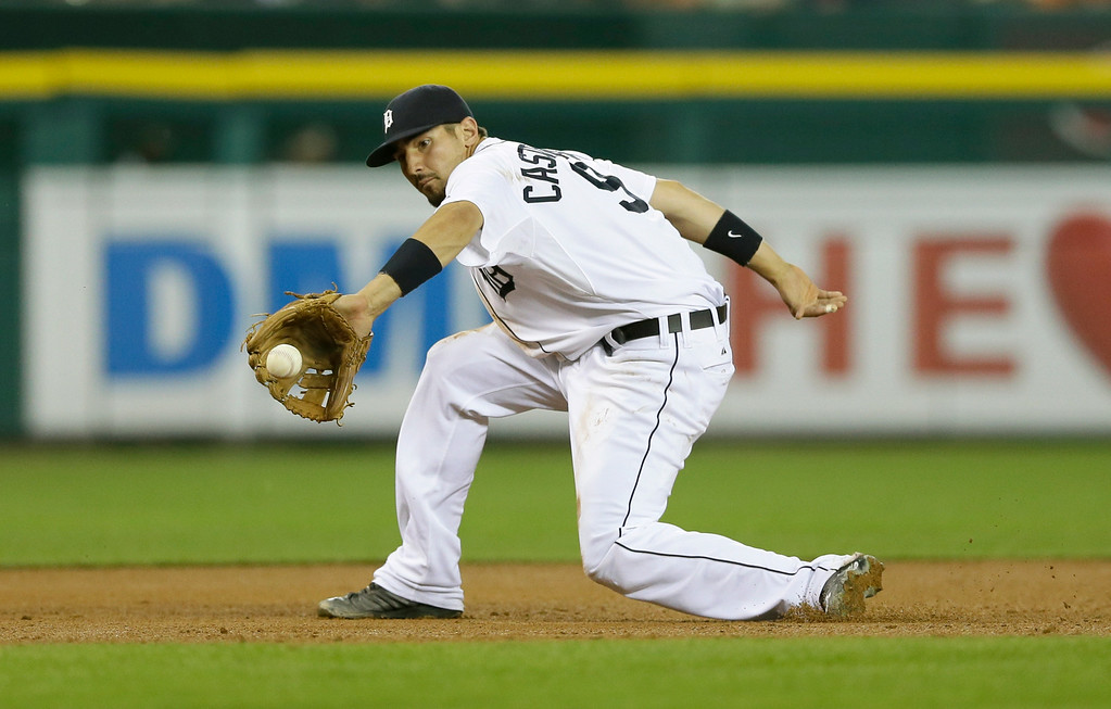 . Detroit Tigers third baseman Nick Castellanos fields a grounder hit by Colorado Rockies\' Josh Rutledge during the seventh inning of an interleague baseball game, Friday, Aug. 1, 2014, in Detroit. (AP Photo/Carlos Osorio)