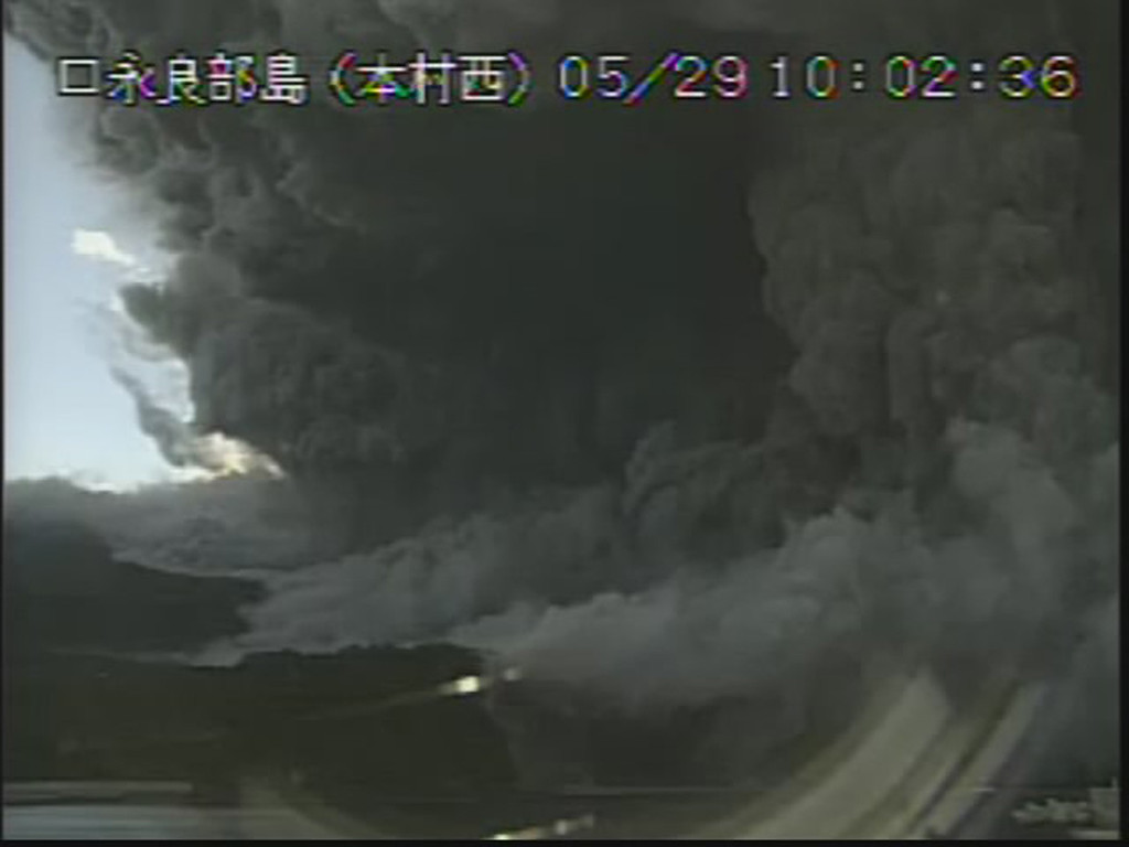 . In this image taken from a surveillance camera observed from Motomura Nishi on Kuchinoerabu island, a column of black smoke rises from Mount Shindake, on the island, southern Japan, Friday, May 29, 2015. The volcano erupted on the small island about 10 a.m. local time Friday, spewing black clouds of ash and rock towering into the sky and prompting authorities to tell residents to evacuate the island. (Japan Meteorological Agency via AP)