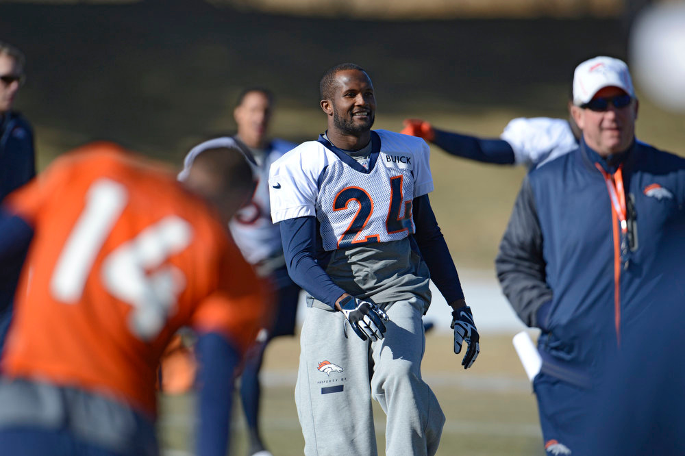 . Denver Broncos cornerback Champ Bailey (24)  smiles as he stretches during  practice Wednesday, January 9, 2013 at Dove Valley.  John Leyba, The Denver Post
