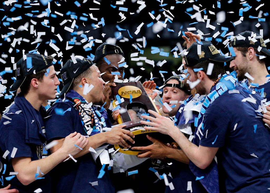 . Villanova players celebrate with the trophy after beating Michigan 79-62 in the championship game of the Final Four NCAA college basketball tournament, Monday, April 2, 2018, in San Antonio. (AP Photo/Eric Gay)