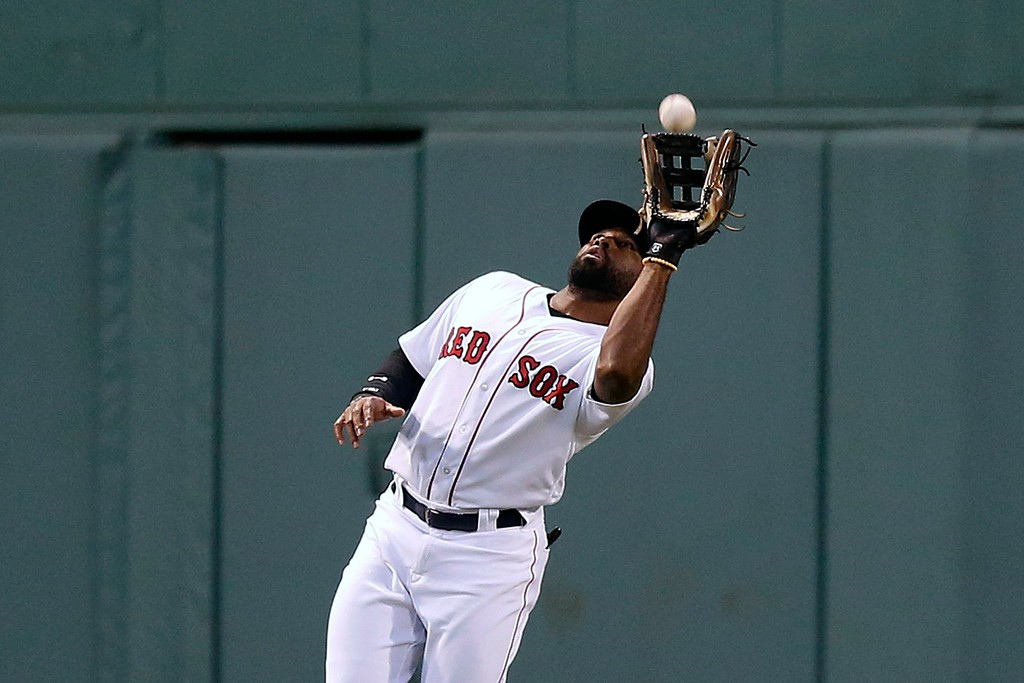 . Boston Red Sox\'s Jackie Bradley Jr. makes the catch o the fly out by Cleveland Indians\' Yan Gomes during the second inning of a baseball game in Boston, Tuesday, Aug. 21, 2018. (AP Photo/Michael Dwyer)