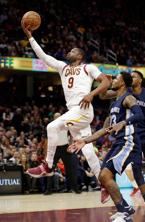 . Cleveland Cavaliers\' Dwyane Wade (9) drives to the basket against Memphis Grizzlies\' Ben McLemore (23) in the first half of an NBA basketball game, Saturday, Dec. 2, 2017, in Cleveland. (AP Photo/Tony Dejak)