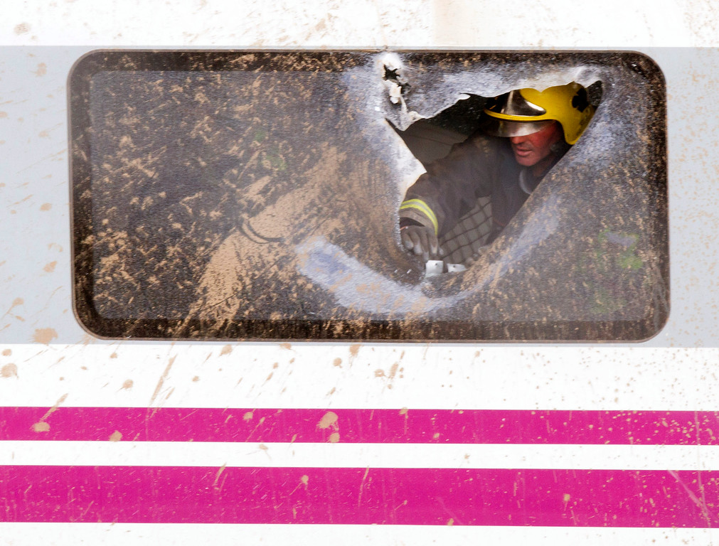 . A firefighter works inside a derailed carriage at the site of a train accident in Santiago de Compostela, Spain, Thursday, July 25, 2013.  (AP Photo/Lalo Villar)