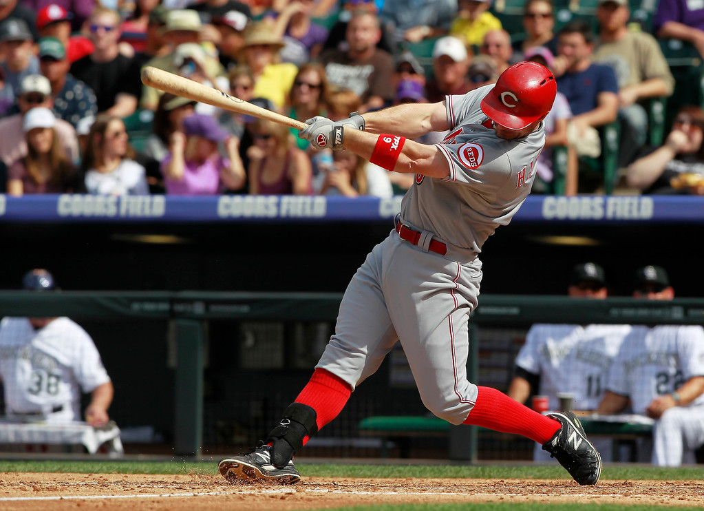 . Cincinnati Reds\' Jack Hannahan singles against the Colorado Rockies in the fourth inning of a baseball game in Denver, Sunday, Sept. 1, 2013. (AP Photo/David Zalubowski)