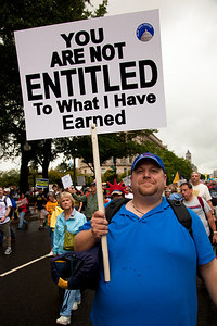 """Home made signs were in abundance as Tea Partiers marched down Pennsylvania Avenue in Washington DC for a second 9/12 rally on September 12, 2010. Entitlement spending was a main focus. This sign reads """"You Are Not Entitled To What I Have Earned"""". (Photo by Jeff Malet)"""