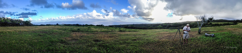 Photographer setting up. iPhone panorama. That's Maui in the distance.