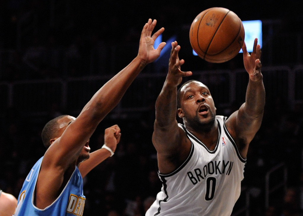 . NEW YORK, NY - DECEMBER 03:  Andray Blatche #0 of the Brooklyn Nets and Darrell Arthur #00 of the Denver Nuggets compete for a rebound during the first half at Barclays Center on December 3, 2013 in the Brooklyn borough of New York City. (Photo by Maddie Meyer/Getty Images)