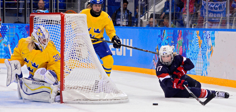 . epa04083384 Jocelyne Lamoureux (R) of USA goes for the puck against Sweden in the third period during the semi final match between USA and Sweden at the Shayba Arena in the women\'s Ice Hockey tournament at the Sochi 2014 Olympic Games, Sochi, Russia, 17 February 2014.  EPA/LARRY W. SMITH
