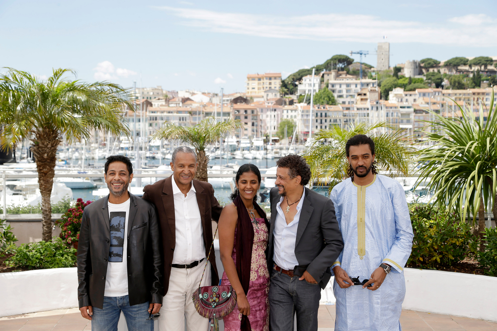 . From left, actor Hitchem Yacoubi, director Abderrahmane Sissakoduring, actress Toulou Kiki, actor Abel Jafri and actor Ibrahim Ahmed dit Pino pose during a photo call for Timbuktu at the 67th international film festival, Cannes, southern France, Thursday, May 15, 2014. (AP Photo/Thibault Camus)