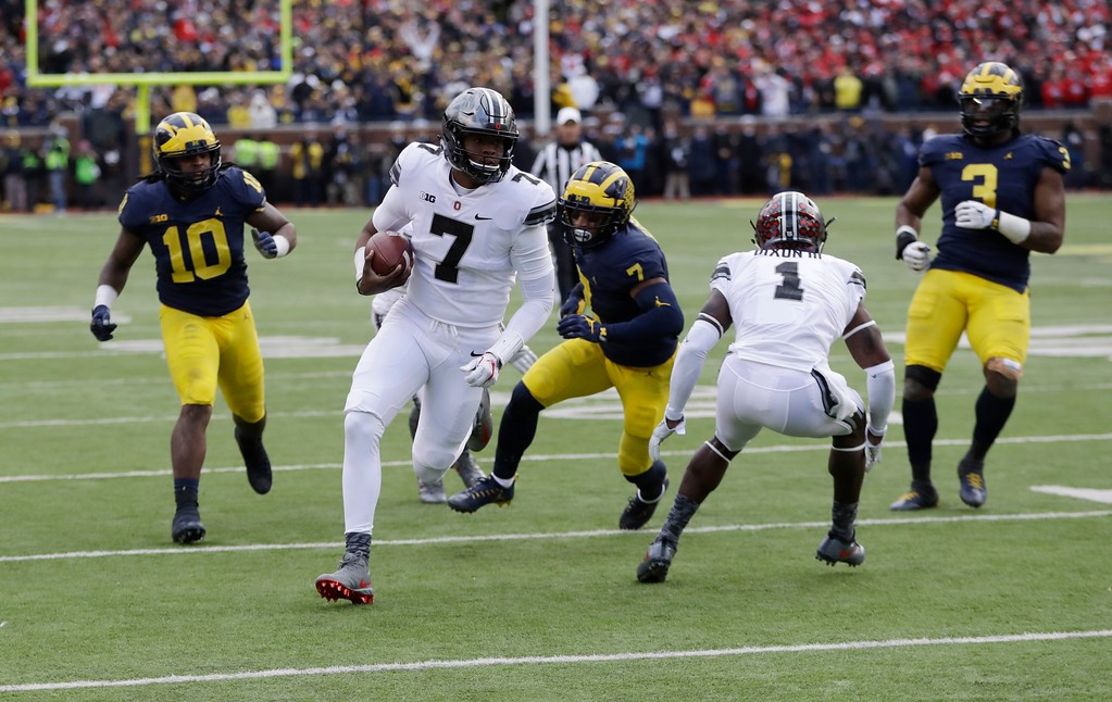 . Ohio State quarterback Dwayne Haskins (7) scrambles to the one-yard line during the second half of an NCAA college football game against Michigan, Saturday, Nov. 25, 2017, in Ann Arbor, Mich. (AP Photo/Duane Burleson)
