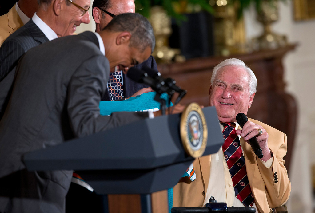 . 1972 Miami Dolphins head football coach Don Shula, right, shares a laugh with President Barack Obama, during a ceremony in the East Room of the White House in Washington, Tuesday, Aug. 20, 2013, where the president honored the Super Bowl VII football champion Miami Dolphins. The 1972 Miami Dolphins remain the only undefeated team in NFL history. (AP Photo/Evan Vucci)