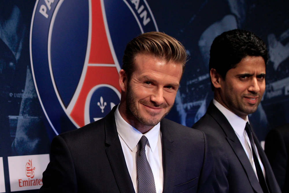 . Soccer player David Beckham (L) attends a news conference in Paris in this January 31, 2013 file photo. Former England captain David Beckham announced on 16 May that he will retire from professional soccer at the end of the season. REUTERS/Gonzalo Fuentes/Files