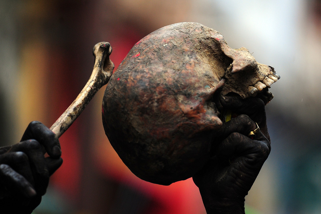 . An Indian Hindu devotee holds a human skull and bone during a procession for Maha Shivaratri, dedicated to the Hindu god Lord Shiva, in Allahabad on February 27, 2014. AFP PHOTO/SANJAY Kanojia/AFP/Getty Images