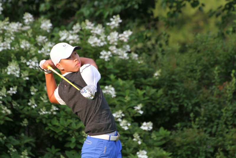 Tianlang Guan of China tees off during the second round of the 2014 Western Amateur.