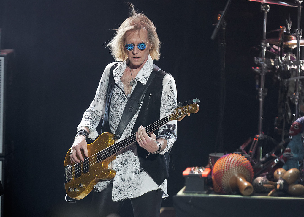 . Tom Hamilton of Aerosmith performs on Tuesday, Sept. 9, 2014, at DTE Energy Music Theatre in Independence Township. Photo by Ken Settle