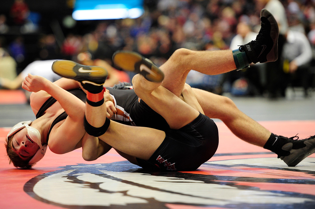 . Jeremy Ashton of Mead gets rolled over by Kyle Cisneros of Jefferson during the Class 3A 126 pound championship during the finals of the 2016 Colorado Wrestling State Championships at the Pepsi Center on February 20, 2016 in Denver, Colorado. (Photo by Brent Lewis/The Denver Post)