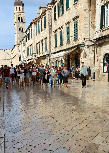 The glossy limestone pavement worn to a sheen by millions of footsteps along the Stradun - the main promenade between the western Pile Gate and the eastern Ploče Gate of the Old City - Dubrovnik