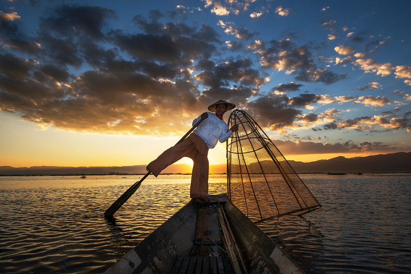 These Burmese fishermen have mastered an unusual technique when it comes to paddling their boats.  Carefully balancing on one leg, wrapping their second leg around the oar to guide the vessel through the freshwater lake.  The skilled technique means the fishermen can stand and look out for reeds in the water and keep both hands free to handle the cumbersome nets.  Inle Lake, Myanmar. Thanks