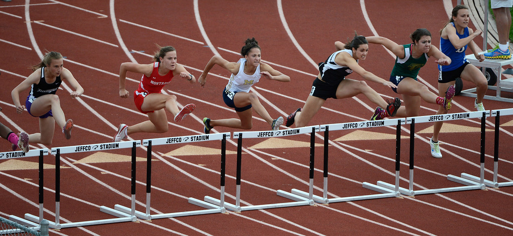 . Taylor Klein, Mullen High School, third from left, over the first hurdle during the girls 4A 100 meter hurdles final at the Colorado State Track and Field Championships at Jeffco Stadium, Saturday, May 18, 2013. Klein won the race with a time of 14.55. (Photo By Andy Cross/The Denver Post)