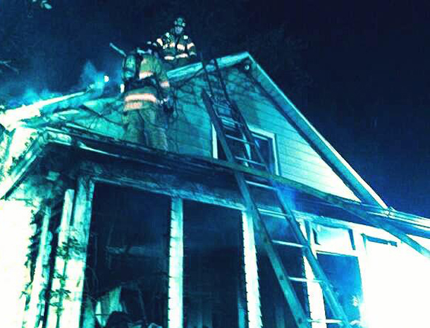 . Kingston firefighters work at the scene of the house fire at 262 Linderman Ave. in Kingston Sunday evening. (Freeman photo by Paula Ann Mitchell)