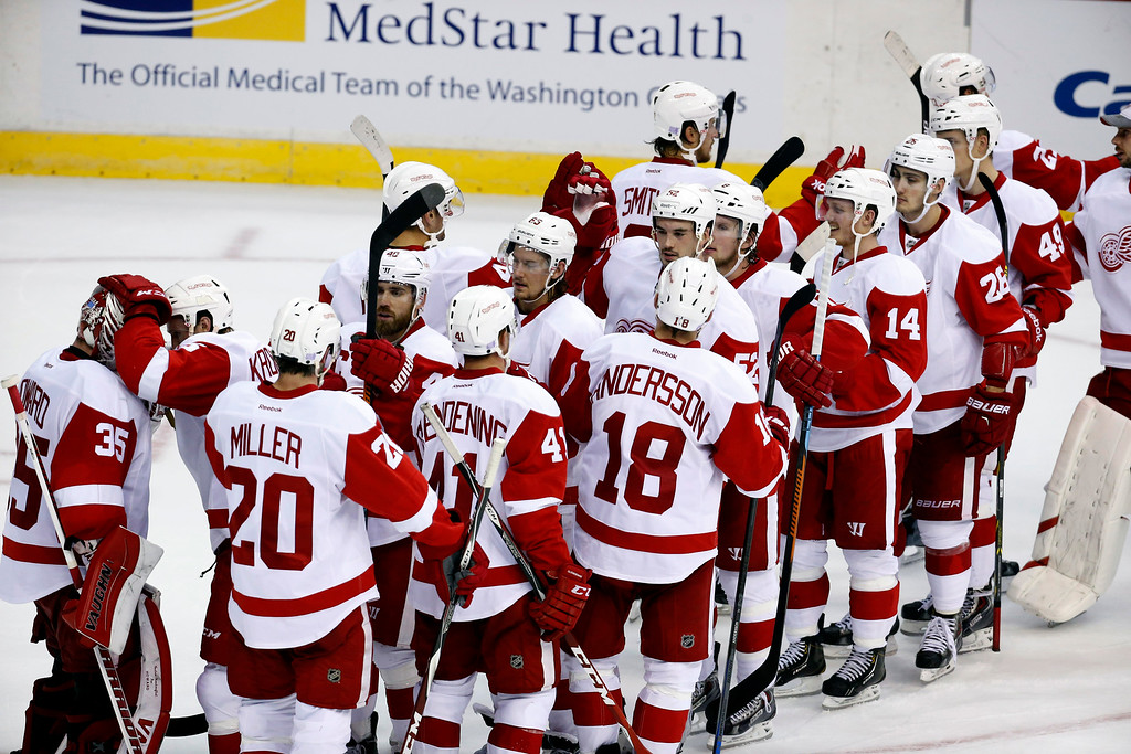 . The Detroit Red Wings celebrate after an NHL hockey game against the Washington Capitals, Wednesday, Oct. 29, 2014, in Washington. The Red Wings won 4-2. (AP Photo/Alex Brandon)