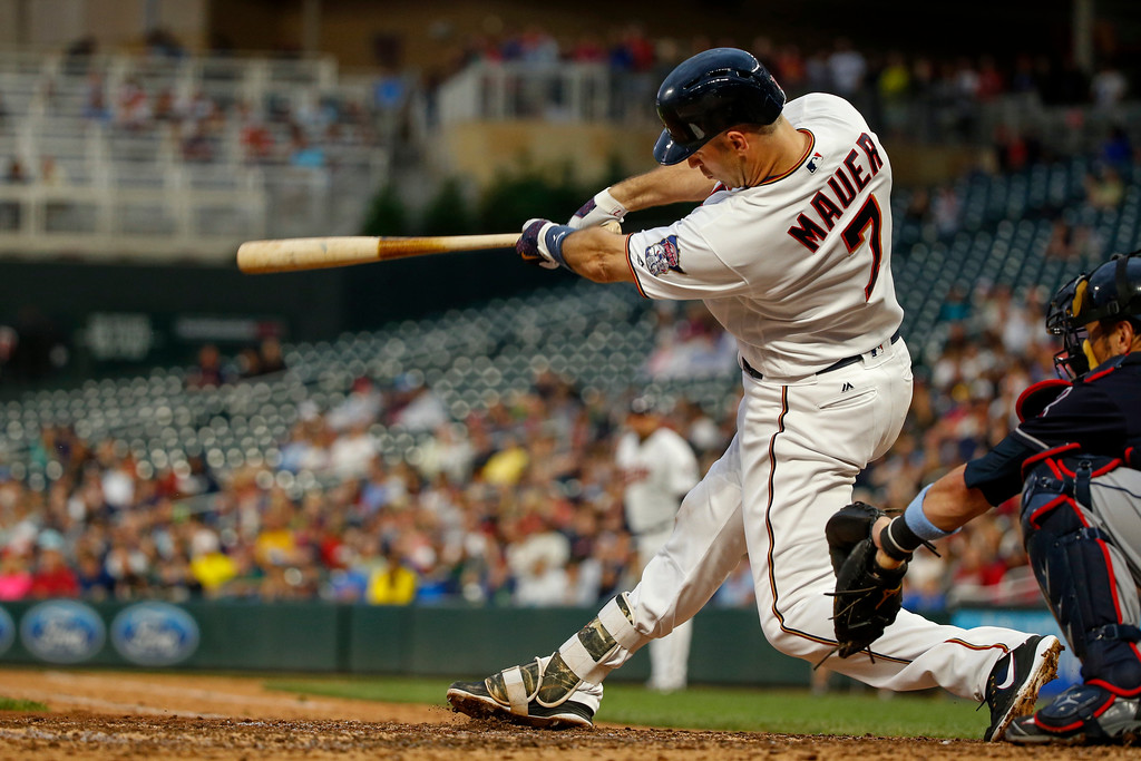 . Minnesota Twins Joe Mauer hits an RBI double against the Cleveland Indians in the third inning of the second baseball game of a doubleheader Saturday, June 17, 2017, in Minneapolis. (AP Photo/Bruce Kluckhohn)