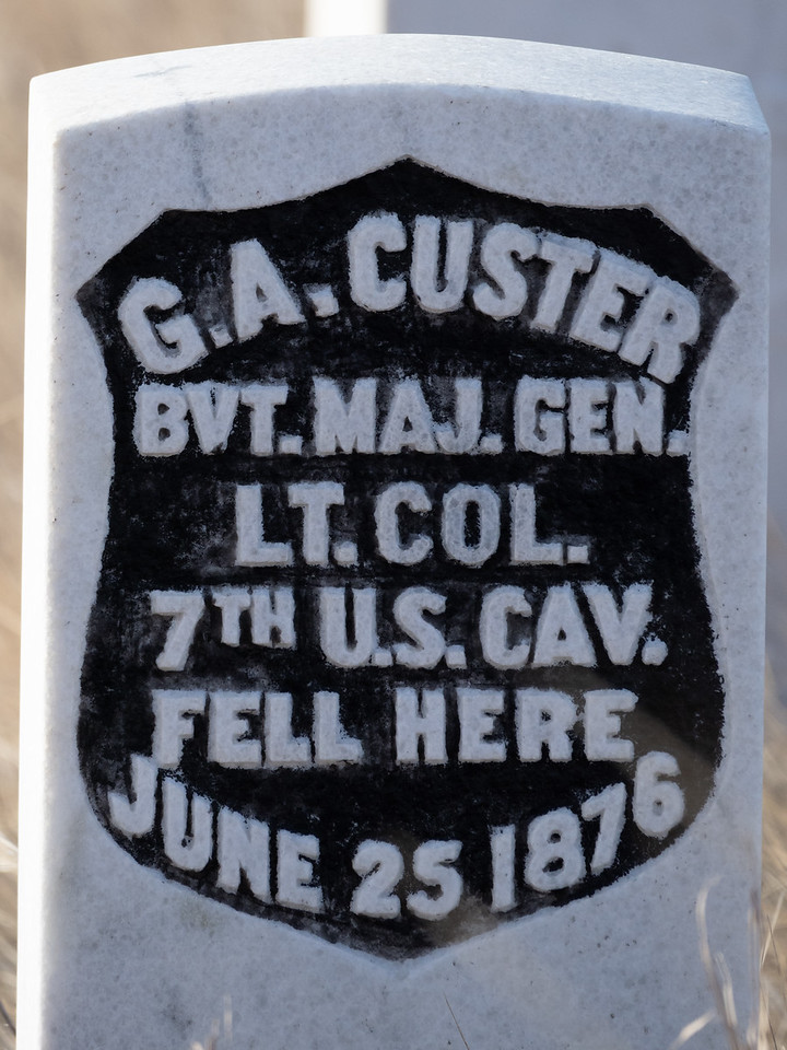 White tombstone with black writing for General Custer