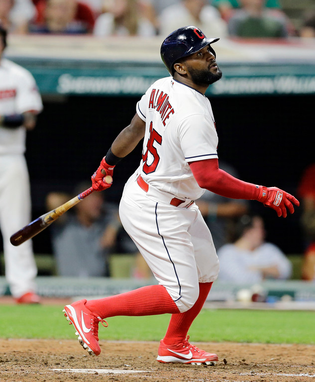 . Cleveland Indians\' Abraham Almonte watches his three-run home run off Toronto Blue Jays relief pitcher Jeff Beliveau during the seventh inning of a baseball game, Friday, July 21, 2017, in Cleveland. Jose Ramirez and Carlos Santana scored on the play. (AP Photo/Tony Dejak)