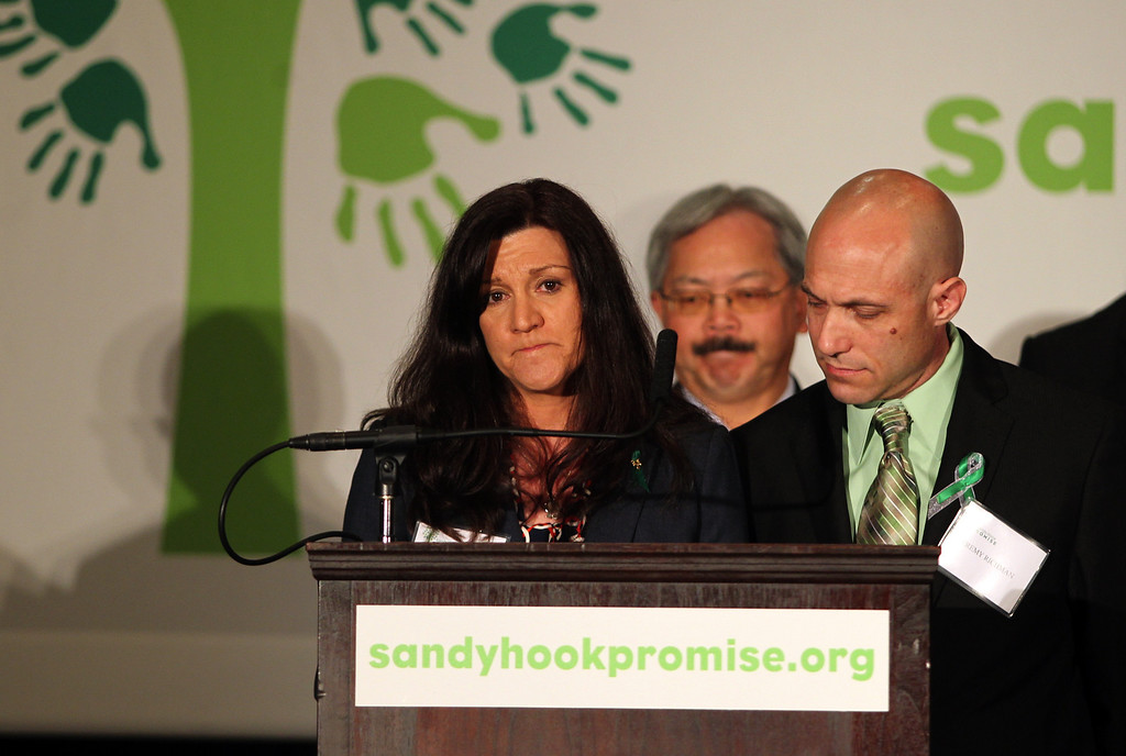 . Parents of Avielle Richman, 6, one of the victims in the Sandy Hook school shooting, Jennifer Hensel and Jeremy Richman speak as San Francisco Mayor Ed Lee looks on at a news conference to launch the Sandy Hook Promise Innovation Initiative held in honor of the three month anniversary of the tragic shooting at Sandy Hook Elementary School at the Bill Graham Civic Auditorium in San Francisco, Calif., on Thursday, March 14, 2013. (Anda Chu/Staff)