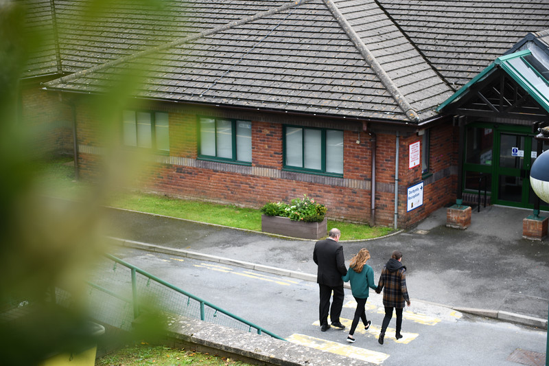 Llanelli, 21st September 2018 Byron John, father of Bradley John who hanged himself at his school, St John Lloyd Roman Catholic, delivers a letter to the school. Byron John heads into the school, hand-in-hand with his daughter, Danielle who found her brother and partner, Kate Pickard.